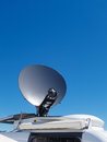 News van satellite dish parked tv transmits breaking events to orbiting satellites for broadcast around the world Stock Photos