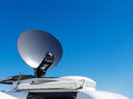 News van satellite dish parked tv transmits breaking events to orbiting satellites for broadcast around the world Royalty Free Stock Photos