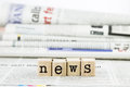 News wording on newspaper background concept close up wooden text Royalty Free Stock Images
