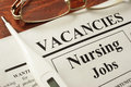 Newspaper with ads nursing jobs vacancy. Royalty Free Stock Photo