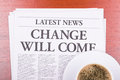 The newspaper  CHANGE WILL COME  and coffee Royalty Free Stock Image
