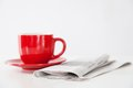 Newspaper and a coffee cup Royalty Free Stock Photo