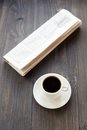Newspaper and cup of coffee on table wooden Royalty Free Stock Photo