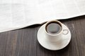 Newspaper and cup of coffee on table Royalty Free Stock Photo