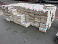 Newspaper delivery london uk june a large on the pavement near a road here you can see large amounts of bundles of newspapers Royalty Free Stock Image