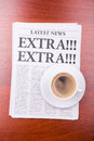 The newspaper EXTRA! EXTRA!  and coffee Royalty Free Stock Image