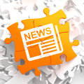 Newspaper icon with news word on orange puzzle mass media concept Stock Images