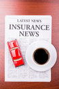 The newspaper  INSURANCE NEWS and auto Royalty Free Stock Photography