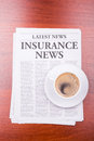 The newspaper INSURANCE NEWS and coffee Royalty Free Stock Photography