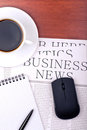Newspaper, notebook, mouse and cup of coffee Royalty Free Stock Photography