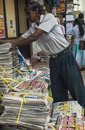Newspaper stand in kandy sri lanka aug unidentified news paper vendor unpacking morning hindi newspapers on the street on aug sri Stock Image