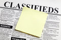 Newspaper and sticky note Royalty Free Stock Photo