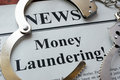 Newspaper with title Money laundering.