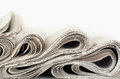 Newspapers abstract wavy formation closeup Stock Photos