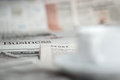 Newspapers and coffee cup macro shot with shallow depth of field Royalty Free Stock Photo