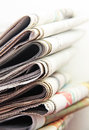 Newspapers colored print media magazines and Royalty Free Stock Photo