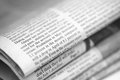 Newspapers heap close up black and white shallow depth of field Royalty Free Stock Image