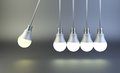 Newton`s cradle made of light bulbs. Idea motion concept.