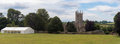 Newton St. Philip church and village green Royalty Free Stock Photo