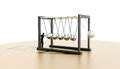 Newtons cradle lone worker against Stock Photography