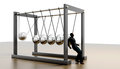 Newtons cradle lone worker against Royalty Free Stock Photo