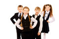 Next generation group of cheerful schoolchildren standing together isolated over white Royalty Free Stock Photo
