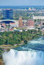 Niagara falls closeup in the day over river with buildings Stock Photo