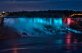 Niagara falls nighttime panorama a panoramic view of the american side of the illuminated by floodlights from the canadian border Royalty Free Stock Photography