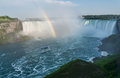 Niagara falls rainbow with boat at Royalty Free Stock Photography