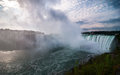 Niagara falls taking a cold wet tour of in the misty morning in november Stock Images