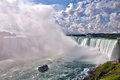 Niagara horseshoe falls and the maid of the mist carries passengers to base part in ontario canada Stock Photos
