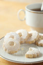 Nibbled italian Canestrelli biscuits near a cup of black tea Royalty Free Stock Photo