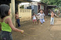 Nicaraguan children while jumping rope on street