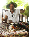 Nicaraguan jewelry artist selling necklaces bracelets earrings a at resort corn island nicaragua central america wearing hat made Stock Photo