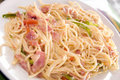 Nicaraguan spaghetti bacon peppers Stock Photo