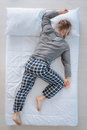 Nice adult man sleeping on his belly Royalty Free Stock Photo
