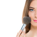 Nice appearance half faced portrait of a young woman with a make up brush over white Royalty Free Stock Photography