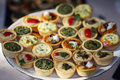 Nice aranjment with mini tarts catering for party Royalty Free Stock Photo