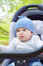 Nice baby boy outdoors on baby carriage age of months Stock Photography