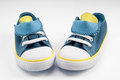 Nice baby s canvas shoes on white background Royalty Free Stock Photography