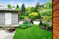 Nice back yard landscape desing with well kept lawn. Royalty Free Stock Photo