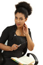 The nice black girl with a notebook and the pen Royalty Free Stock Photo
