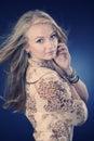 Nice blonde lady posing in studio Royalty Free Stock Photo