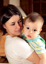 Nice boy with mother little baby mommy pretty women and cheerful child play game happy smiling young lady hugging son new Stock Images
