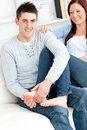 Nice boyfriend massaging his girlfriend's feet Stock Image