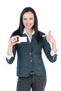 Nice businesswoman showing blank card in her hand pointing on it with finger and smiling Royalty Free Stock Photos