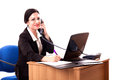 Nice businesswoman speaking on the phone caucasian working at her desk and Royalty Free Stock Photo