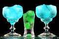 Nice color drinks with ice on black background Stock Images