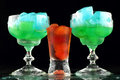 Nice color drinks with ice on black background Royalty Free Stock Photography