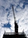 Nice crane silhouette of a on construction site Royalty Free Stock Photography